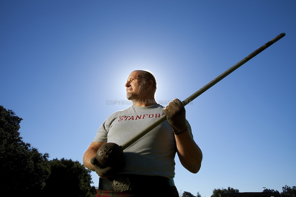 Alan Hebert holding a Scottish hammer, practices for the Scottish Highland Games held in Alameda, California.