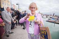 "@Licensed to London News Pictures 07/09/15. Ramsgate, Kent. Councillor and Deputy Mayor for Ramsgate Sarah Larkin holds the Ukip Party ""Say No To The EU"" Tour leaflet. Nigel Farage Leader of the UKIP Party  goes on walkabout today to launch his party's ""Say No To The EU"" Tour in Ramsgate town centre. Photo credit: Manu Palomeque/LNP"