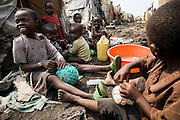 Boys make soccer balls out of plastic bags and rope  in the Mugunga II IDP camp on the outskirts of Goma, Democratic Republic of Congo, on Wednesday December 17, 2008.