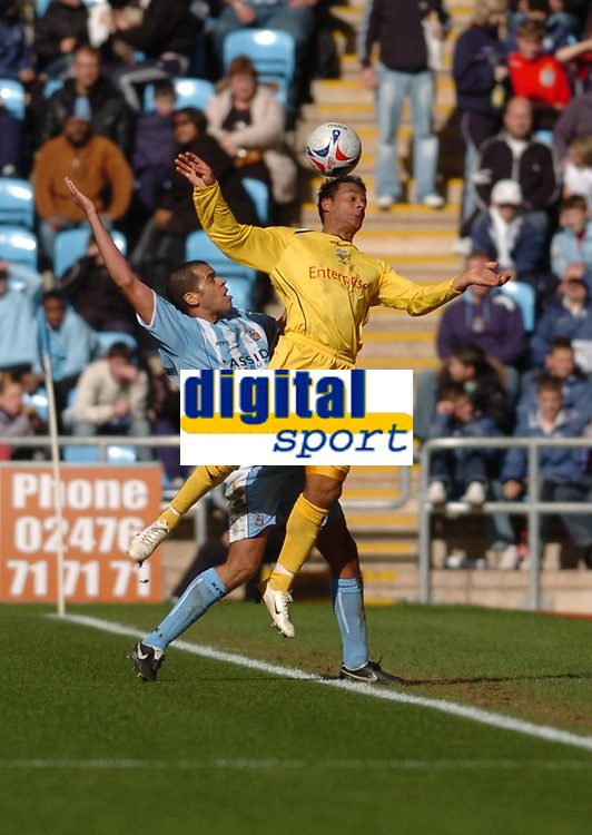Photo: Leigh Quinnell.<br /> Coventry City v Preston North End. Coca Cola Championship. 01/04/2006. Prestons Simon Whaley wins the ball in the air from Coventrys Marcus Hall.