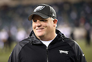 Philadelphia Eagles head coach Chip Kelly smiles during pregame warmups before the NFL NFC Wild Card football game against the New Orleans Saints on Saturday, Jan. 4, 2014 in Philadelphia. The Saints won the game 26-24. ©Paul Anthony Spinelli