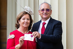 Parents Mr. Joaquin Echeverria Alonso and Maria, Mrs. Miralles De Imperial Hornedo of London Bridge attack hero receive the medal awarded to their late son, Mr. Ignacio Echeverria at an investiture by Her Majesty The Queen at Buckingham Palace in London. London, October 11 2018.
