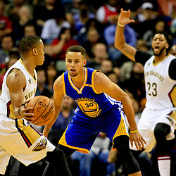 Oct 28, 2016; New Orleans, LA, USA;  New Orleans Pelicans guard Tim Frazier (2) is guarded by Golden State Warriors guard Stephen Curry (30) as forward Anthony Davis (23) calls for the ball during the first quarter of a game at the Smoothie King Center. Mandatory Credit: Derick E. Hingle-USA TODAY Sports