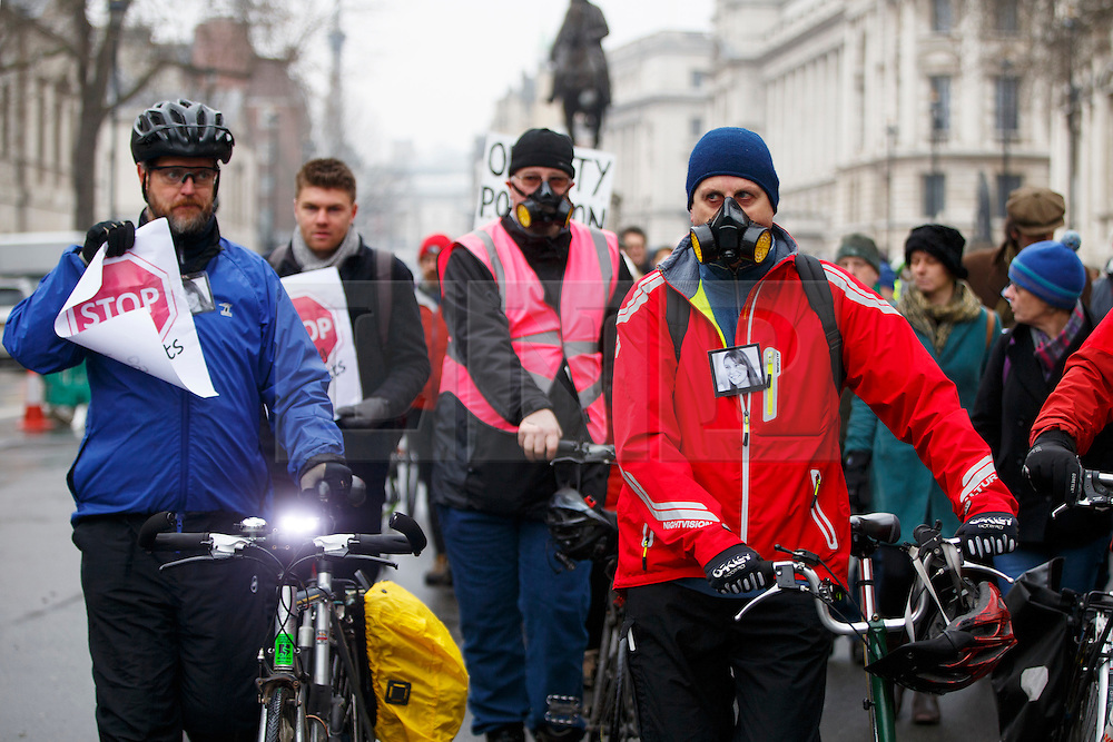 © Licensed to London News Pictures. 11/02/2017. London, UK. Cyclists march in Westminster, London following the deaths of Anita Szucs, 30 and Karla Roman, 32 both killed while cycling on Monday on the streets of London. Protesters asking for the government to commit to significantly increase funding for cycling and walking starting with 5% of the 2017 transport budget and increasing to 10% by 2020. Photo credit: Tolga Akmen/LNP