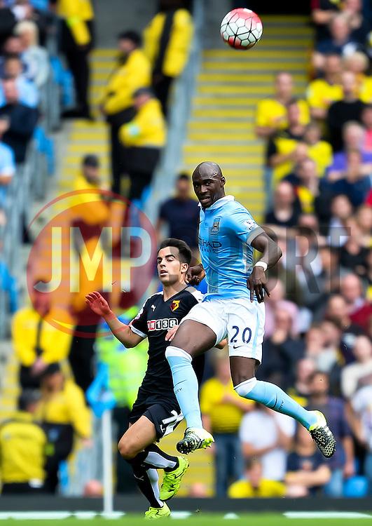 Eliaquim Mangala of Manchester City challenges Watford's Jose Manuel Jurado  - Mandatory byline: Matt McNulty/JMP - 07966386802 - 29/08/2015 - FOOTBALL - Etihad Stadium -Manchester,England - Manchester City v Watford - Barclays Premier League