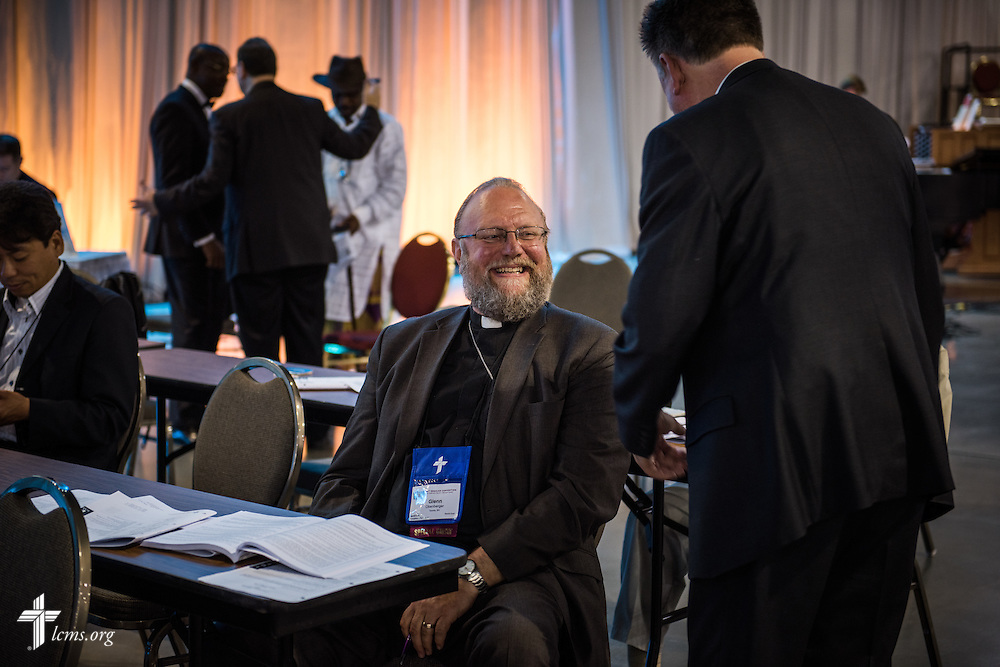 The Rev. Glenn Obenberger, special guest from the Evangelical Lutheran Synod, chats with the Rev. Dr. Jon Vieker,  senior assistant to the LCMS president, on Tuesday, July 12, 2016, at the 66th Regular Convention of The Lutheran Church–Missouri Synod, in Milwaukee. LCMS/Frank Kohn