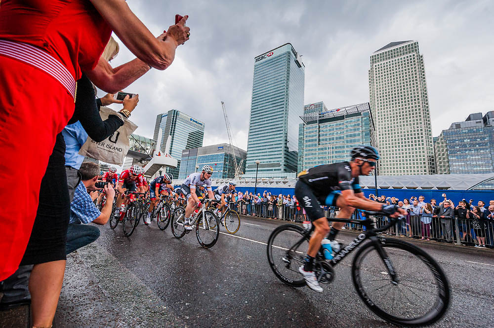 The third leg of the 2014 Tour de France passes Canary Wharf in the Docklands. Aspen Way, London 07 July 2014.