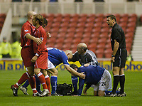 Photo. Glyn Thomas.<br /> Middlesbrough v Everton. Carling Cup Round 4.<br /> Riverside Stadium, Middlesbrough. 03/12/2003.<br /> Everton's James McFaddon receives treatment after falling controversially after a tackle from George Boateng. Gaizka Mendieta needed to be restrained by Danny Mills in the aftermath.