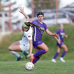 Carroll's Taryn Neameyer tackles Easter Oregon's Taylor Boyer Sunday at Nelson Stadium. The Saints battled back to tie the Mountaineers 3-3.