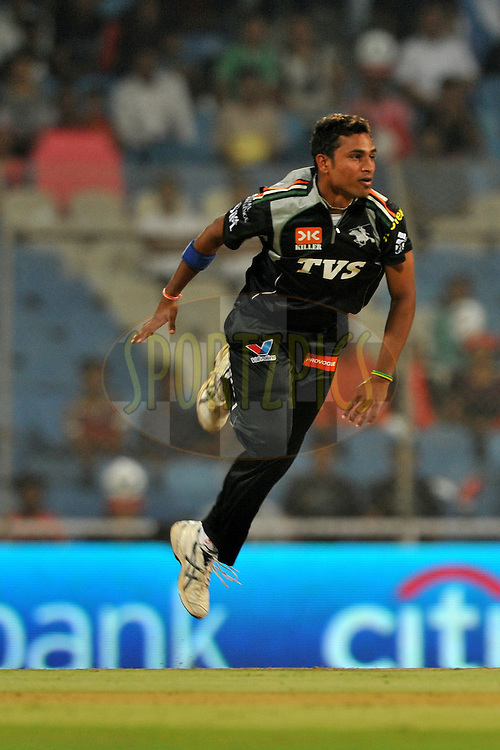 Shrikant Wajh of Pune Warriors India bowls during  match 10 of the Indian Premier League ( IPL ) Season 4 between the Pune Warriors and the Kochi Tuskers Kerala held at the Dr DY Patil Sports Academy, Mumbai India on the 12th April 2011..Photo by Pal Pillai /BCCI/SPORTZPICS