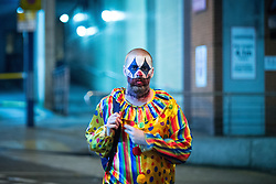 © Licensed to London News Pictures . 01/11/2015 . Manchester , UK . A clown . Halloween revellers , wearing make up and costumes , out and about in Manchester City Centre . Photo credit : Joel Goodman/LNP