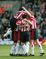Photo: Scott Heavey<br />Southampton V West Bromwich Albion. 01/03/03.<br />James Beattie is mobbed by his team-mates after scoring the opener for the Saints during this premiership clash at St. Marys stadium, home of Southampton.