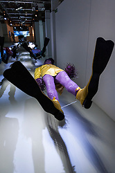 © Licensed to London News Pictures. 17/02/2016. London, UK. Suspended mannequins wear flipper-like shoes at the London College of Fashion MA16 exhibition in Holborn which opened today.  The event features student work from across LCF's postgraduate courses and reveals visions and pieces from the next generation of fashion designers, artists, business professionals and media makers.. Photo credit : Stephen Chung/LNP