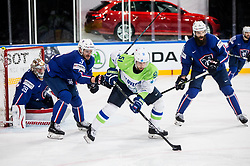 Cristobal Huet of France, Jonathan Janil of France, Mitja Robar of Slovenia and Antonin Manavian of France during the 2017 IIHF Men's World Championship group B Ice hockey match between National Teams of France and Slovenia, on May 15, 2017 in AccorHotels Arena in Paris, France. Photo by Vid Ponikvar / Sportida