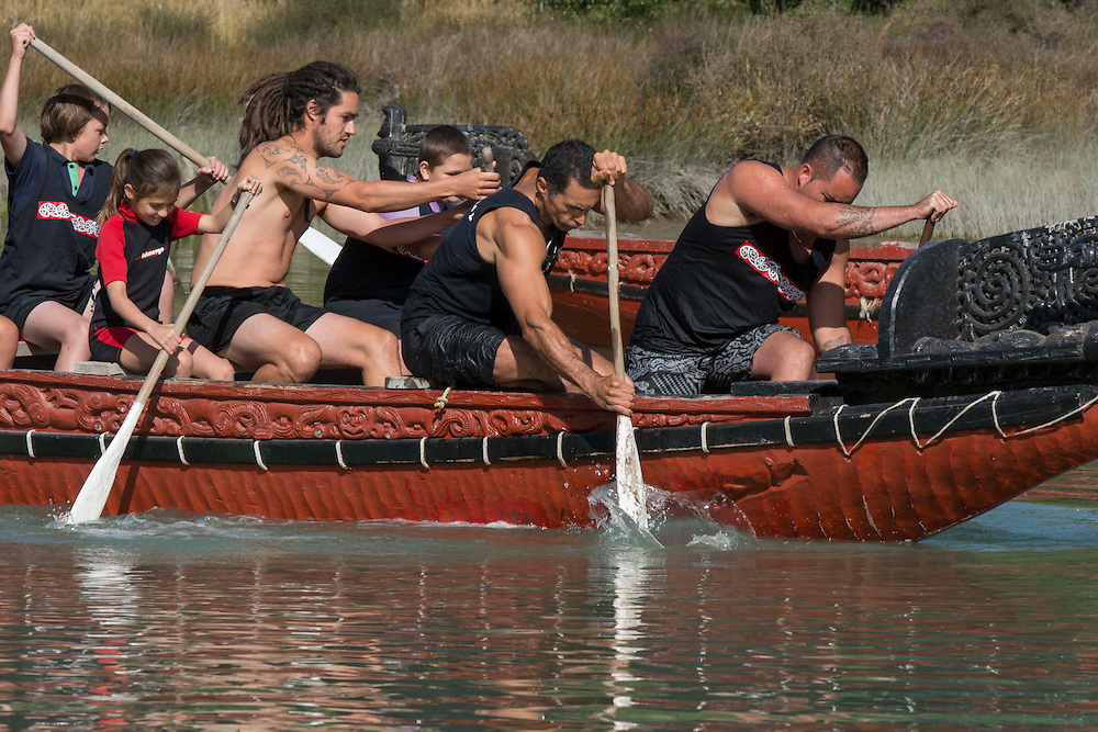 Mihiroa Pauling, second from left, aged 9 is the youngest paddler on the Waka at the Waitangi Day Commemorations, Okains Bay, Banks Peninsula, New Zealand, Thursday, 6 February, 2014.  <br /> Credit:SNPA / David Alexander