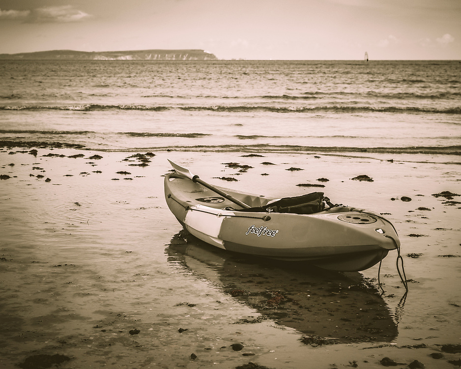 Feel Free to explore. Sea kayak on Avon Beach, Dorset, looking out to The Needles and Isle of Wight