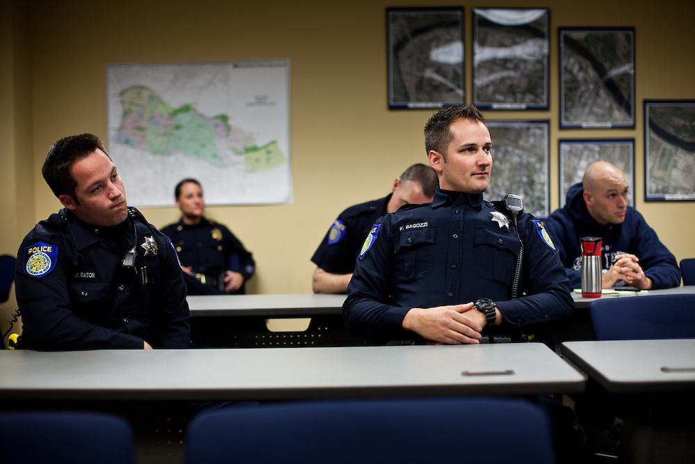 Sacramento Police Department officers gather for roll call at the start of the graveyard shift on  October 26, 2012 in Sacramento, Calif. Budget cuts have decimated the Sacramento Police Department resulting in the elimination of many investigative units.