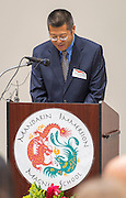 Rev. Junking Tan comments during the dedication and ribbon cutting for the Mandarin Immersion Magnet School, October 24, 2016.