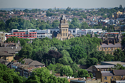 © Licensed to London News Pictures. 14/06/2017. London, UK. A view over the rooftops of Notting Hill and Kensal Green in west London showing the Pall Mall building (centre). Photo credit: Ben Cawthra/LNP