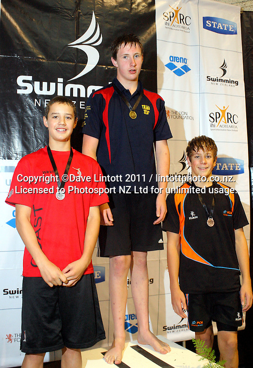 13yo Boys 100m breaststroke podium, from left, Wilrich Coetzee (2), Callum Sinclair (1) and Hamish Trlin (3). New Zealand Age Group Swimming Championships day five at Welllington Aquatics Centre, Kilbirnie, Wellington, New Zealand on Saturday, 5 March 2011. Photo: Dave Lintott / photosport.co.nz