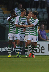 Yeovil Town's Edward Upson celebrates with Yeovil Town's Joe Edwards after scoring to make it 1-1  - Photo mandatory by-line: Alex James/JMP - Tel: Mobile: 07966 386802 25/08/2013 - SPORT - FOOTBALL - Cardiff City Stadium - Cardiff -  Cardiff City V Manchester City - Barclays Premier League