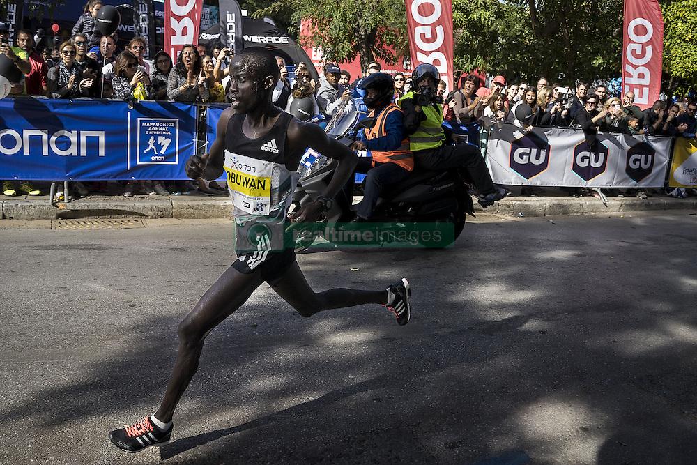 November 13, 2016 - Athens, Greece - Kenyan runner Lobuwan Luka Rotich approaches the finish line, while spectators encourage him, during the 34th Athens Authentic Marathon. Athens, November 13, 2016. (Credit Image: © Kostis Ntantamis/NurPhoto via ZUMA Press)