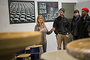 The director of communications at Burley Clay in Rosevillle talks to students and faculty at the College of Fine Arts  during a tour of their manufacturing facility. Photo by Ben Siegel