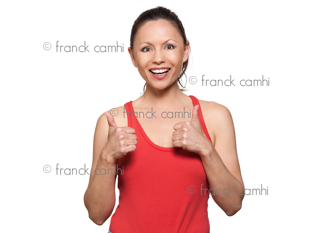 Portrait of cute happy woman gesturing thumbs up in studio on isolated white background