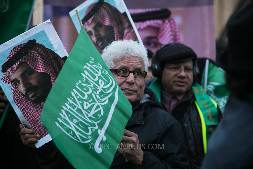 A small group of counter protesters welcoming prince Bin Salman gather next to the protesters agains the visit by Saudi prince Bin Salman opposite Downing Street March 7th 2018 in London, United Kingdom. Many are angry at the Saudi involvement and continued bombing in Yemen with tens of thousands of civilian casualties and many more displaced by the war.