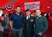 Eric Nelson, Master Sergeant Anthony Parente and Trevor Parente show their support for Veterans Count during the Red, White and Brew Fest at Funspot on Saturday afternoon.  (Karen Bobotas/for the Laconia Daily Sun)