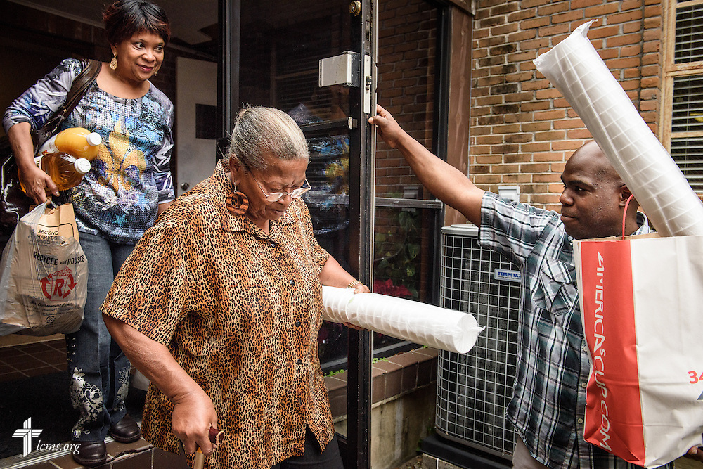 The Rev. Gregory T. Manning, pastor of Gloria Dei Lutheran Church, assists Glenda Gordon (left) and Delores Blanche with bagged food from the Broadmoor Food Pantry next to Gloria Dei on Wednesday, March 9, 2016, in New Orleans. LCMS Communications/Erik M. Lunsford