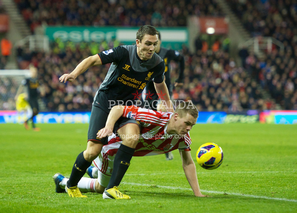 STOKE-ON-TRENT, ENGLAND - Boxing Day Wednesday, December 26, 2012: Liverpool's Stewart Downing is brought down by Stoke City's captain Ryan Shawcross during the Premiership match at the Britannia Stadium. (Pic by David Rawcliffe/Propaganda)