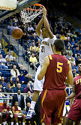 January 9, 2010; Berkeley, CA, USA;  California Golden Bears forward Omondi Amoke (21) dunks in front of Southern California Trojans forward Nikola Vucevic (5) during the first half at the Haas Pavilion.  California defeated USC 67-59.