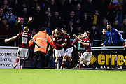 Northamptons goalscorer Ricky Holmes is mobbed by his team mates during the The FA Cup match between Northampton Town and Milton Keynes Dons at Sixfields Stadium, Northampton, England on 9 January 2016. Photo by Dennis Goodwin.