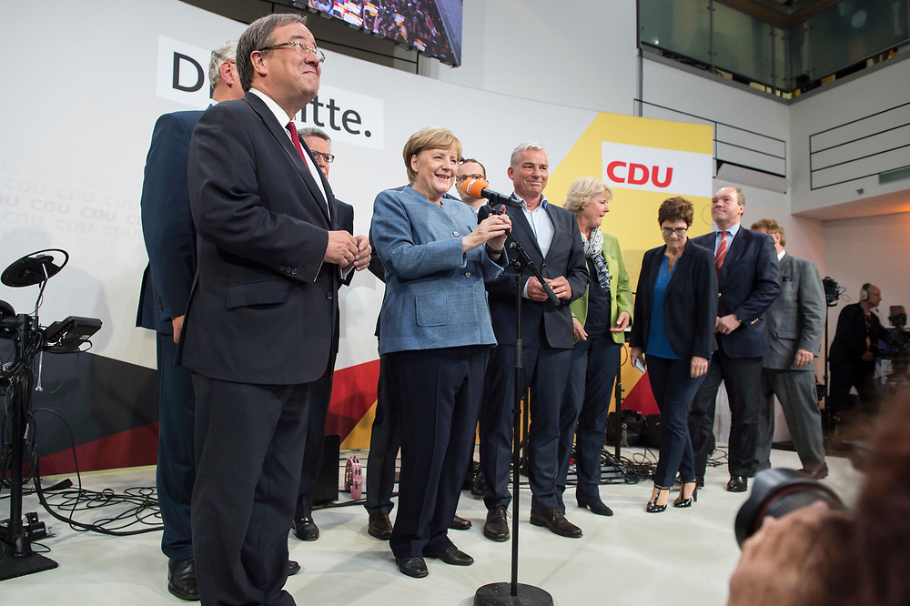 24 SEP 2017, BERLIN/GERMANY:<br /> Angela Merkel (M), CDU, Bundeskanzlerin, eingerahmt von Joachim Herrmann, Armin Laschet, Thomas de Maiziere, Jesn Spahn, Thomas Strobl, Monika Gruetters, Annegret Kramp-Karrenbauer, Philipp Murmann, Elmar Brok, (v.L.n.R.), Wahlparty in der Wahlnacht, Bundestagswahl 2017, Konrad-Adenauer-Haus, CDU Bundesgeschaeftsstelle<br /> IMAGE: 20170924-01-056<br /> KEYWORDS: Election Party, Election Night