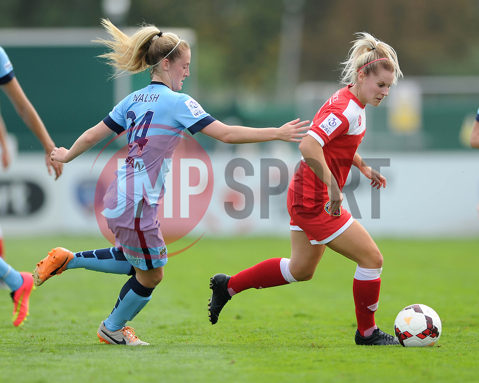 Bristol Academy Womens' Nicola Watts is chased down by Manchester City Womens' Keira Walsh - Photo mandatory by-line: Dougie Allward/JMP - Mobile: 07966 386802 - 28/09/2014 - SPORT - Women's Football - Bristol - SGS Wise Campus - Bristol Academy Women's v Manchester City Women's - Women's Super League