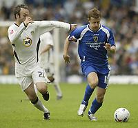 Photo: Aidan Ellis.<br /> Leeds United v Cardiff City. Coca Cola Championship. 19/08/2006.<br /> Cardiff's Paul Parry holds of Leeds Shaun Derry