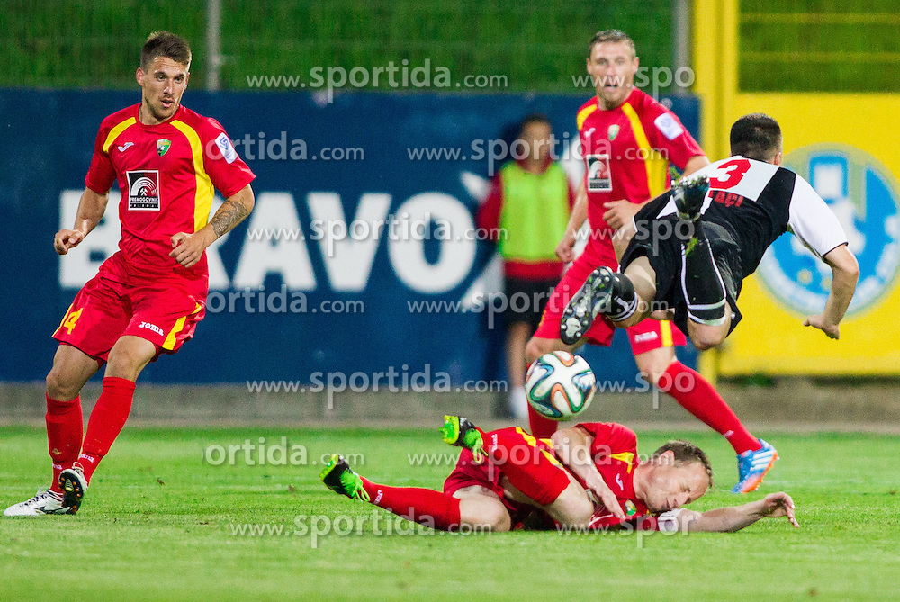 Uros Roser #6 of Rudar vs Cela Emiljan of Laci during football match between NK Rudar Velenje and KF Laci (Albania) in 1st Round of UEFA Europa League Qualifications on July 3, 2014 in Arena Petrol, Celje, Slovenia. Photo By Vid Ponikvar / Sportida