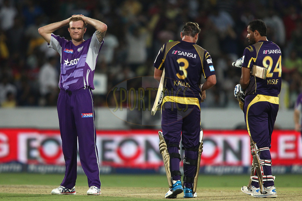 A dejected Doug Bollinger of the Hobart Hurricanes looks on as Kolkata Knight Riders beats Hobart Hurricanes to reach the final during the first semi final match of the Oppo Champions League Twenty20 between the Kolkata Knight Riders and the Hobart Hurricanes held at the Rajiv Gandhi Cricket Stadium, Hyderabad, India on the 2nd October 2014<br /> <br /> Photo by:  Shaun Roy / Sportzpics/ CLT20<br /> <br /> <br /> Image use is subject to the terms and conditions as laid out by the BCCI/ CLT20.  The terms and conditions can be downloaded here:<br /> <br /> http://sportzpics.photoshelter.com/gallery/CLT20-Image-Terms-and-Conditions-2014/G0000IfNJn535VPU/C0000QhhKadWcjYs