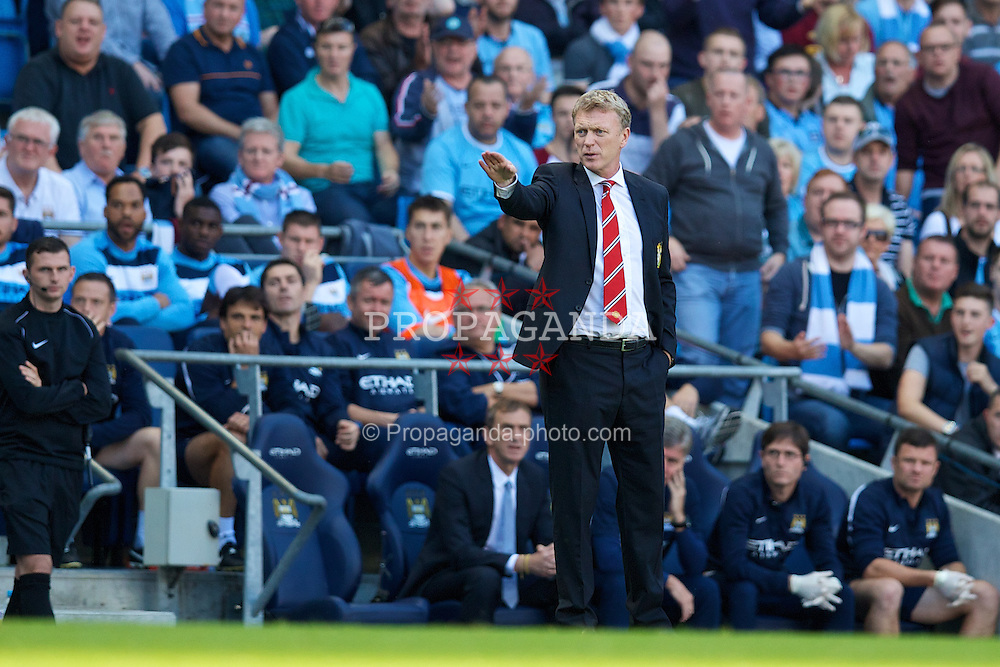 MANCHESTER, ENGLAND - Sunday, September 22, 2013: Manchester United's David Moyes during the Premiership match against Manchester City at the City of Manchester Stadium. (Pic by David Rawcliffe/Propaganda)