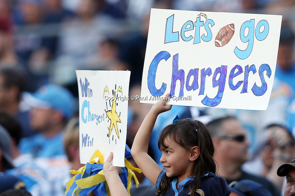 "A young San Diego Chargers fan holds up a sign stating ""Go Chargers"" during the NFL week 13 football game against the Cincinnati Bengals on Sunday, Dec. 1, 2013 in San Diego. The Bengals won the game 17-10. ©Paul Anthony Spinelli"