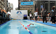 "Diana Nyad swims the final lap of her 48-hour continuous ""Swim for Relief"" to support Hurricane Sandy recovery efforts, Wednesday, Oct. 9, 2013, in New York's Herald Square.  The swim is raising funds at www.NyadSwimforRelief.com for AmeriCares, a non-profit relief organization, with P&G brands such as Duracell, Tide and Secret underwriting the production costs to maximize the funds donated.  (Photo by Diane Bondareff/Invision for P&G/AP Images)"