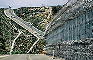 "View of the United States-Mexico border fence at what was formerly called ""Smugglers Gulch"", looking west, in San Ysidro, CA on Thursday, June 8, 2017.(Photo by Sandy Huffaker for The New York Times)"