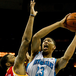 Jan 9, 2013; New Orleans, LA, USA; New Orleans Hornets power forward Anthony Davis (23) shoots over Houston Rockets power forward Marcus Morris (2) during the second quarter of a game at the New Orleans Arena. Mandatory Credit: Derick E. Hingle-USA TODAY Sports
