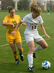 Virginia forward Sarah Curtis (18) keeps the ball from William and Mary forward Claire Zimmeck (25).  The Virginia Cavaliers defeated the William and Mary Tribe 1-0 in the second round of the NCAA Women's Soccer tournament held at Klockner Stadium in Charlottesville, VA on November 18, 2007.