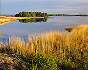 Shallow Lake. East side of Lake Winnipeg proposed Unesco World heritage Site.                                Northern Manitoba                              Copyright Garth Lenz. Contact: lenz@islandnet.com www.garthlenz.com