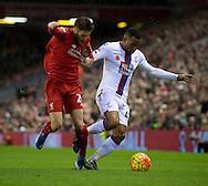 Jason Puncheon of Crystal Palace (right) looks to shrug off Jordon Ibe of Liverpool (left) during the Barclays Premier League match at Anfield, Liverpool<br /> Picture by Russell Hart/Focus Images Ltd 07791 688 420<br /> 08/11/2015