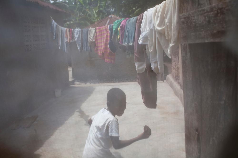 A boy runs outside his home on July 16, 2010 in Corail Henri, Haiti.