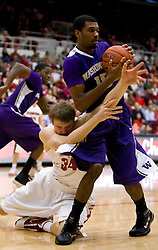 February 13, 2010; Stanford, CA, USA;  Washington Huskies guard Scott Suggs (15) grabs a loose ball from Stanford Cardinal forward Andrew Zimmermann (34) during the first half at Maples Pavilion.  Washington defeated Stanford 78-61.