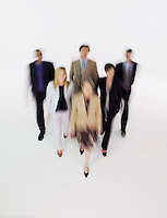 Group of businesspeople walking blurred effect